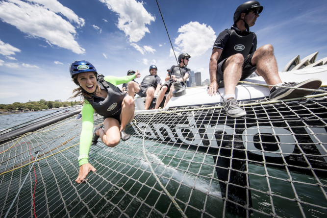 The Extreme sailing Series 2015. Act 8. Sydney. Australia . Australian rugby player Phil Waugh and pro surfer Sally Fitzgibbons onboard the LandRover extreme 40 catamaran in Sydney Harbour today prior to racing Image licensed to Lloyd Images